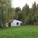 redevelopment of stables and garage to a self build dwelling and art studio