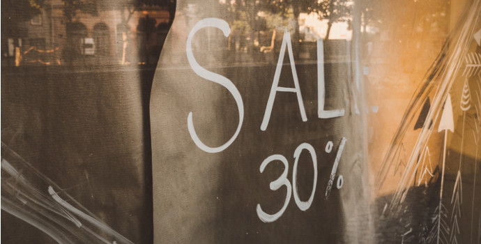 30% off sign in shop window